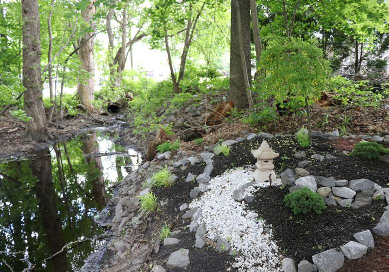 a rock garden by a stream
