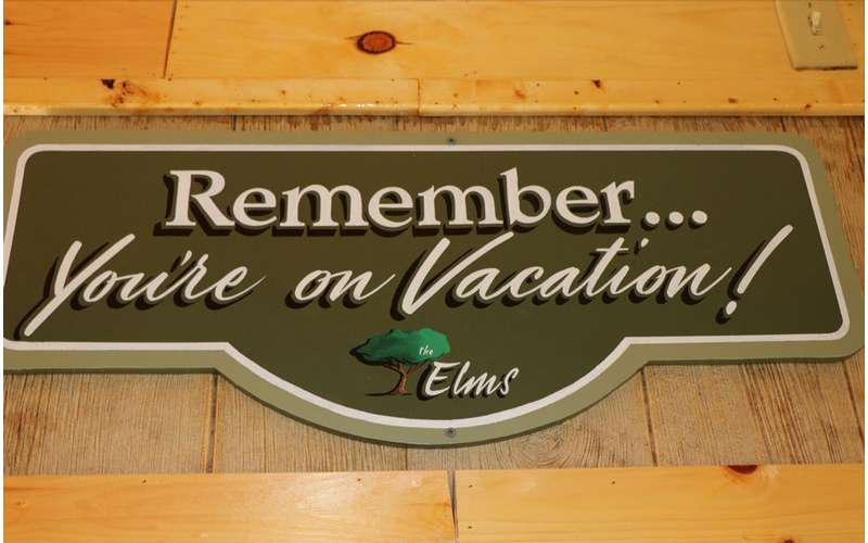 sign that says Remember...You're on Vacation!