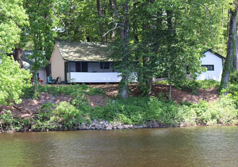 view of small cottage from water