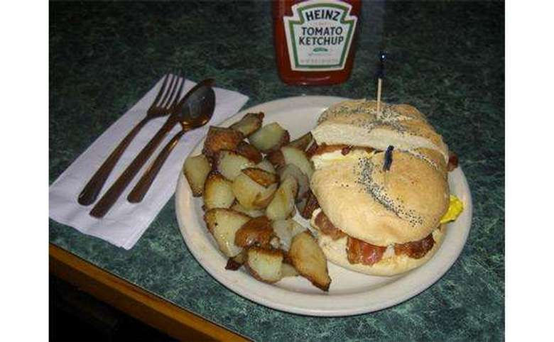 breakfast sandwich with potatoes on a plate