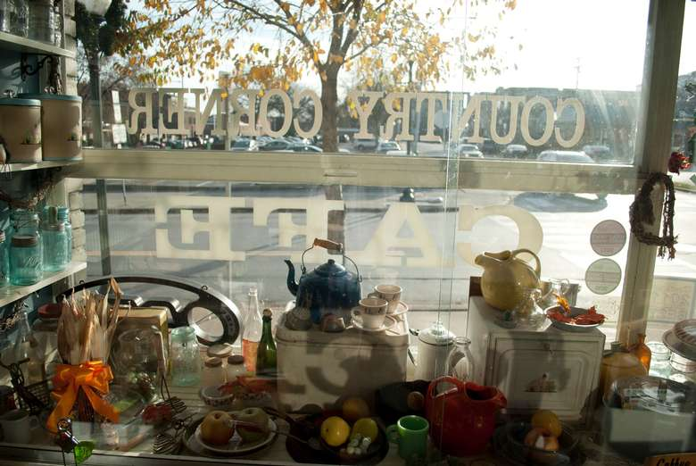 looking through the inside of country corner cafe's main window