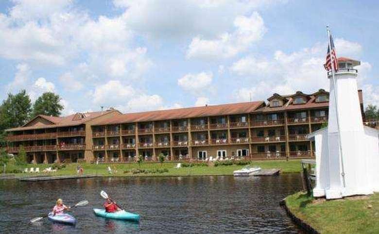 exterior view of hotel showing balconies and kayakers on the water