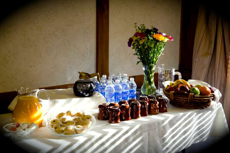 side table set up with coffee, water and fruit