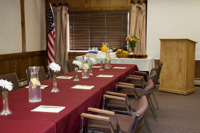 meeting room set with one long table conference room style with speaker podium