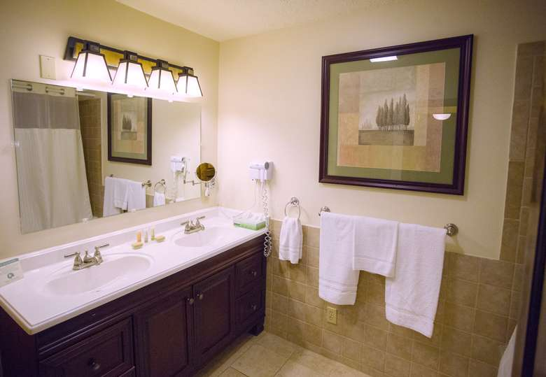 well-lit modern hotel bathroom with double sinks