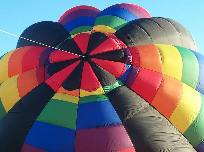 rainbow colored hot air balloon inflating