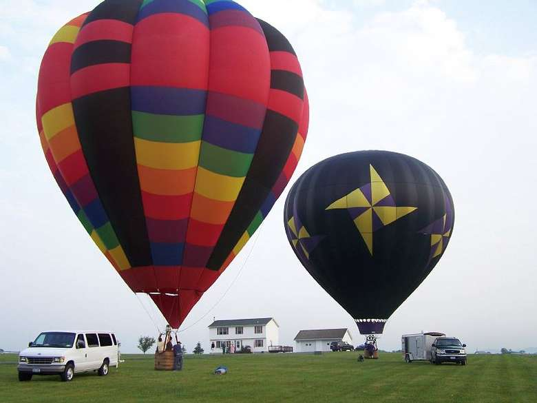 two hot air balloons fully inflated and ready for takeoff