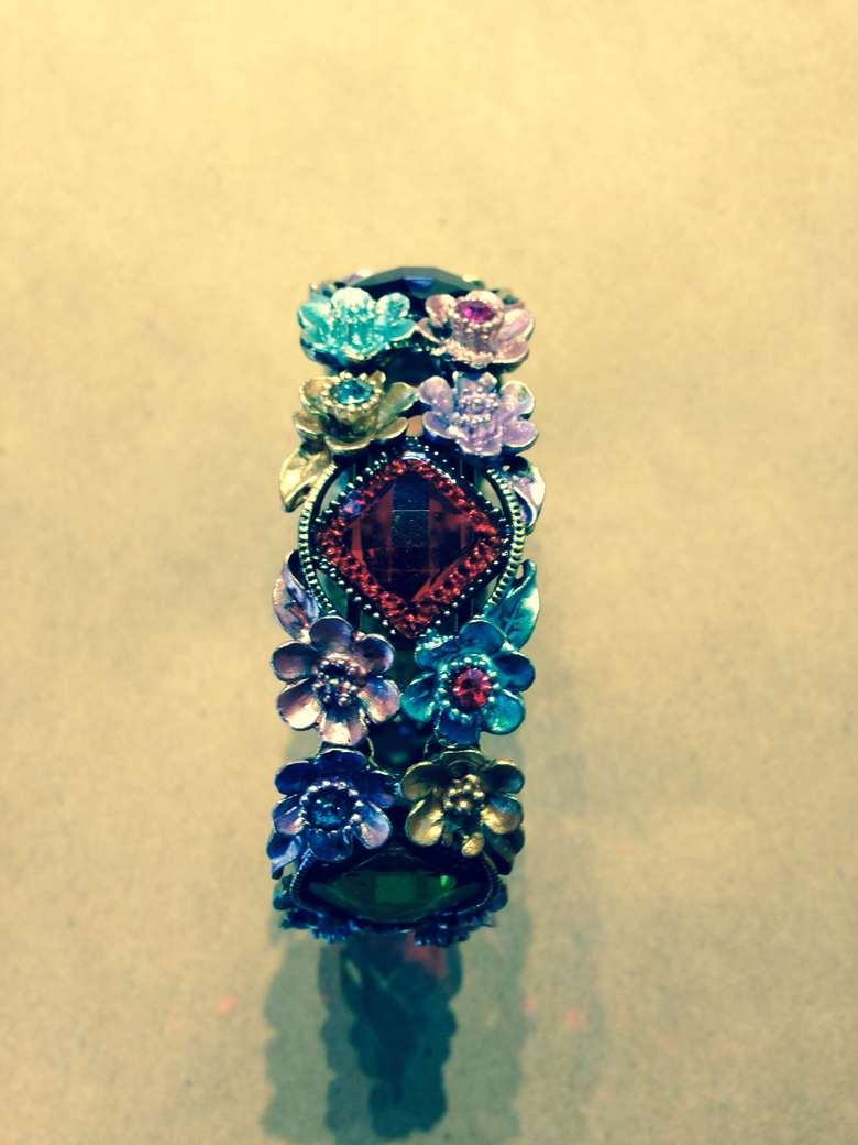 multicolored ring with decorative flowers