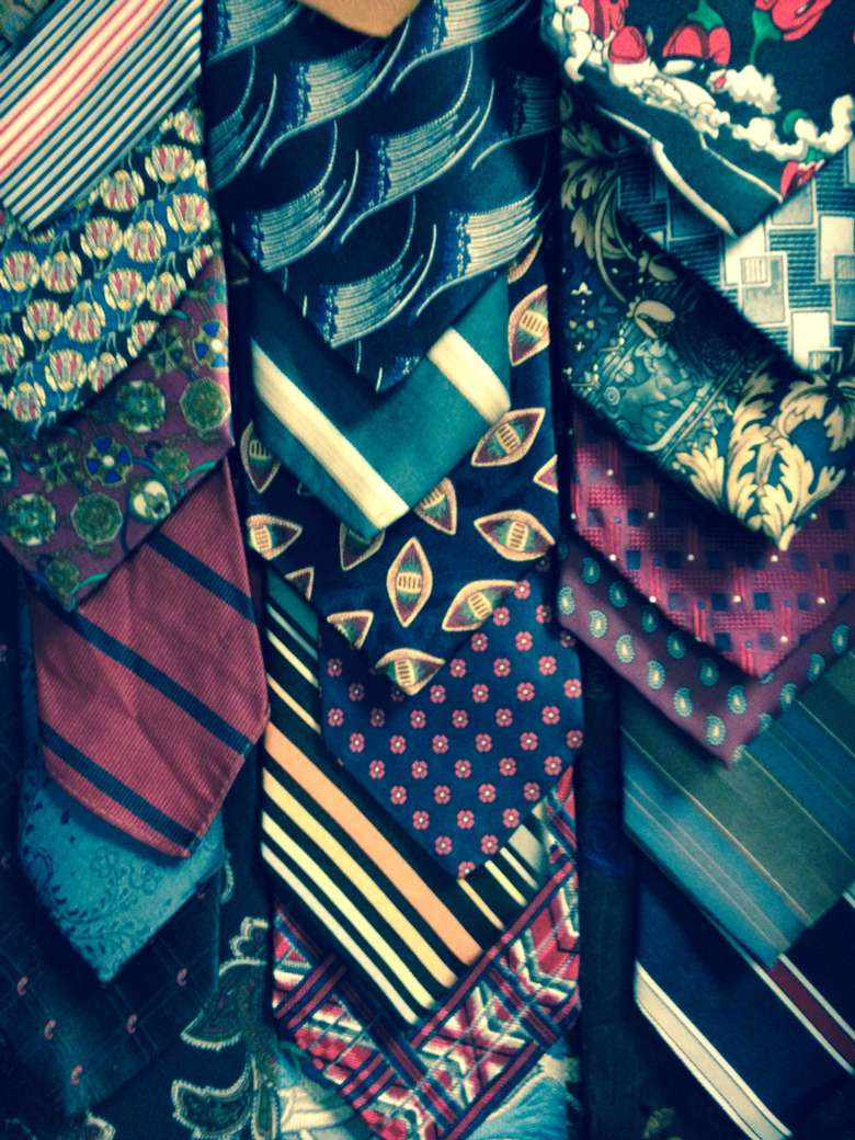 neckties displayed on a table