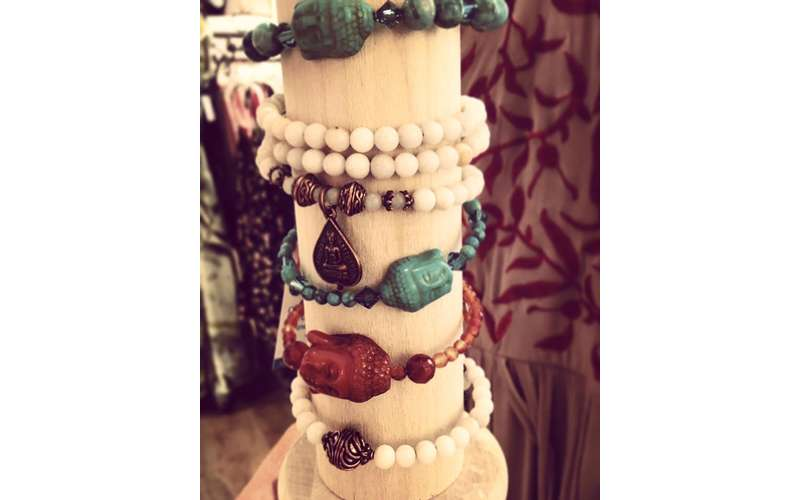 a variety of bracelets with pearls and other gems