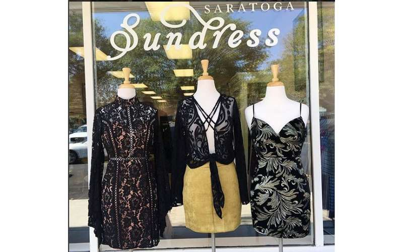 three dresses on display in front of the saratoga sundress store