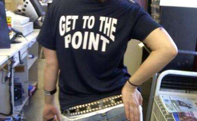 person wearing a navy t-shirt that says get to the point on the back