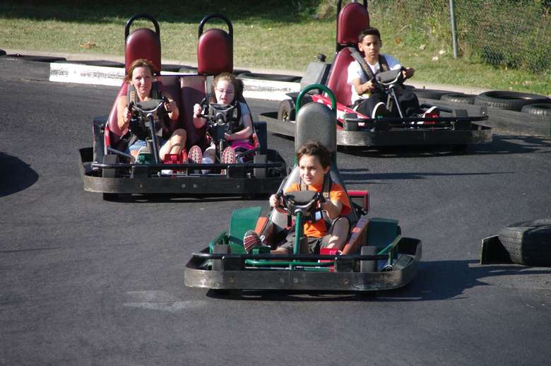 kids and adult on go carts