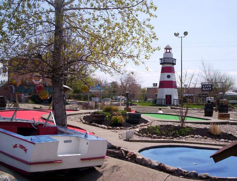 view of mini golf course with boat and light house