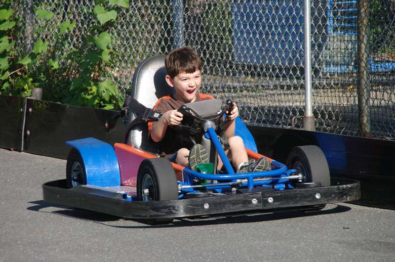 boy looking excited on go cart