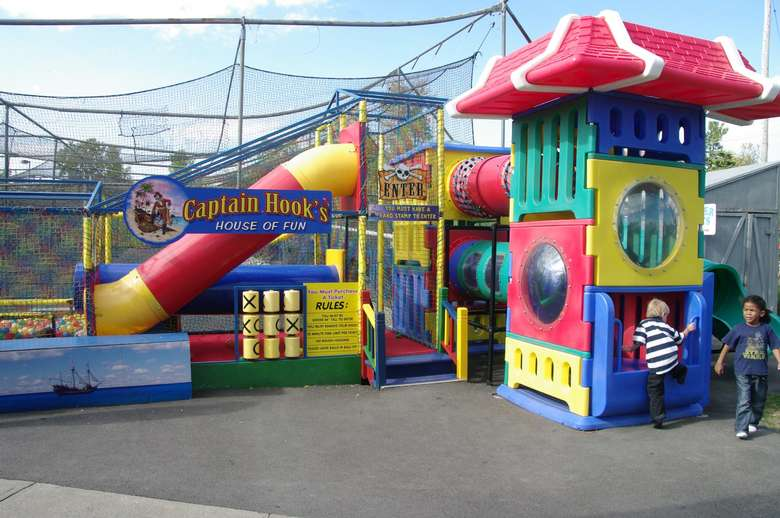 Kids climbing onto Captain Hook's house of fun playground