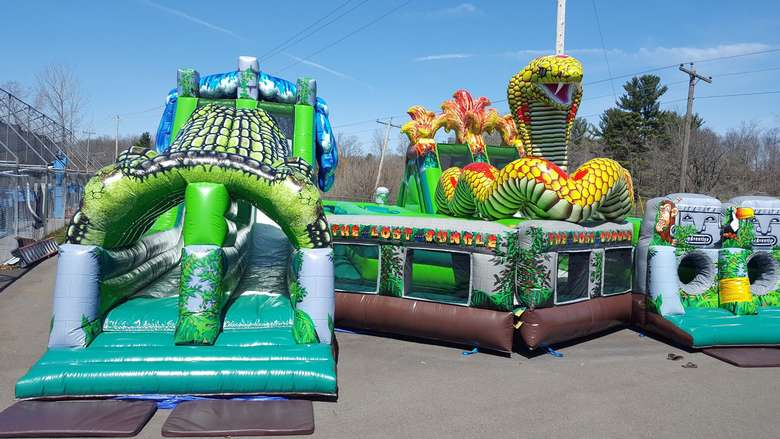 Bounce houses with slides and obstacle course