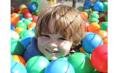 boy in colorful ball pit