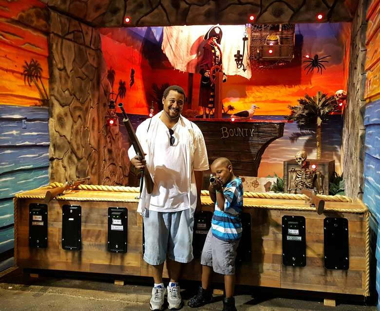 Father and son with fake guns from game