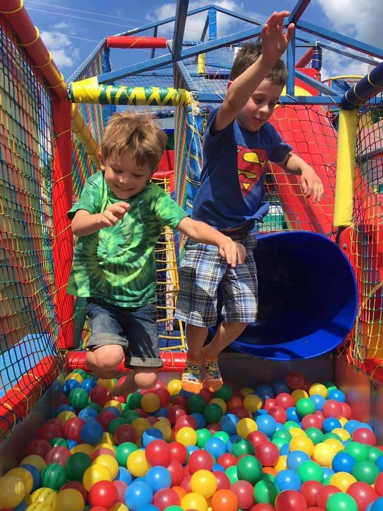 kids jumping into ball pit