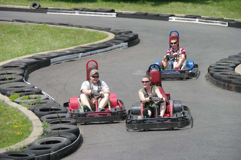 Adult and teens on go carts