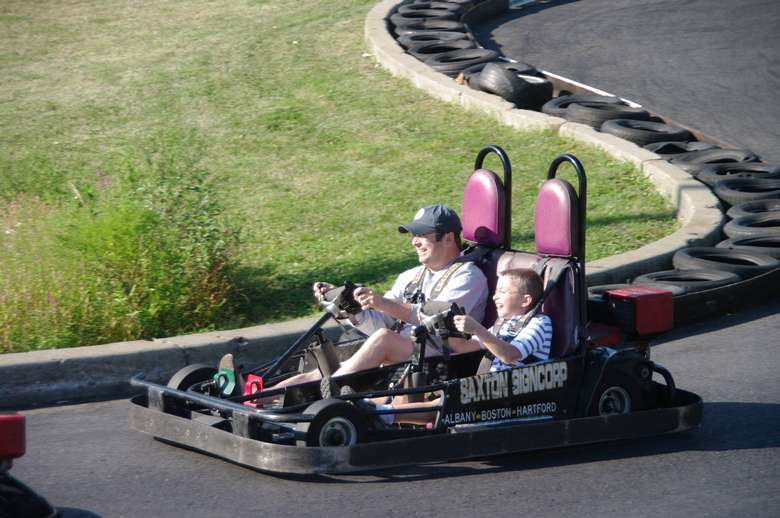 father and son on a go cart together