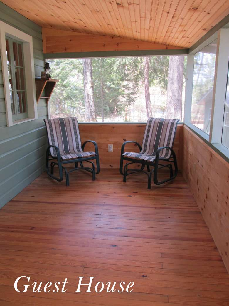 two chairs on a porch