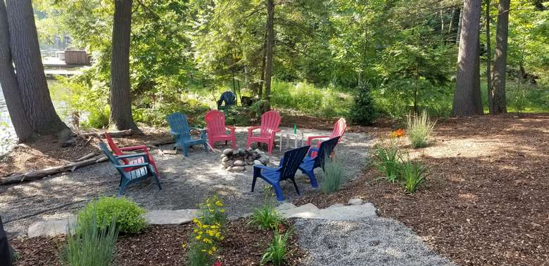 colorful adirondack chairs surrounding a fire pit