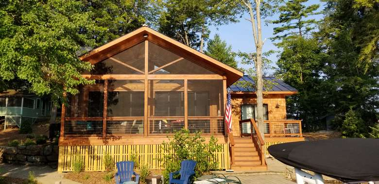 log cabin with a screened-in porch