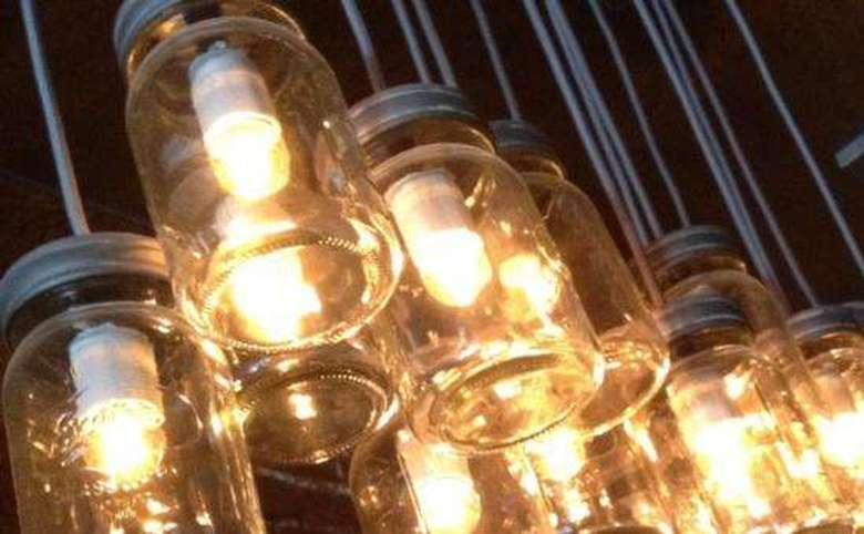 mason jar light fixture hanging from the ceiling