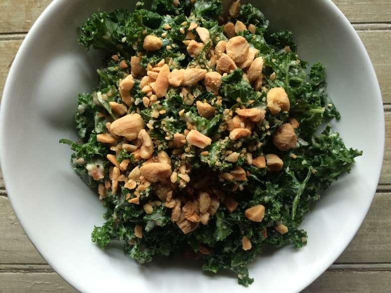 kale salad with nuts on top