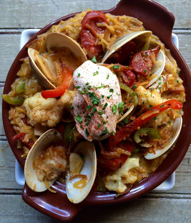 dish with four clams and a dollop of sour cream on top