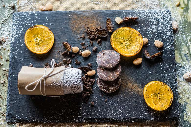dessert on a slate tray with lemon garnishes
