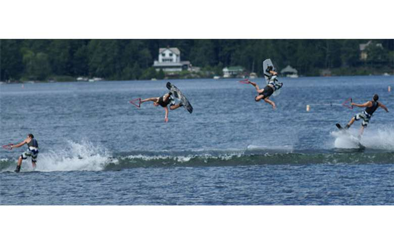 Young man doing a flip on a wakeboard