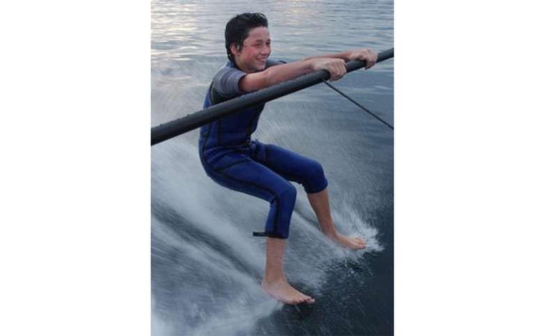 Boy barefoot skiing on a boom