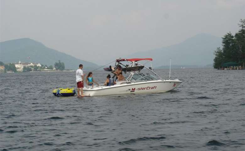 Motor boat getting ready to tow tubers