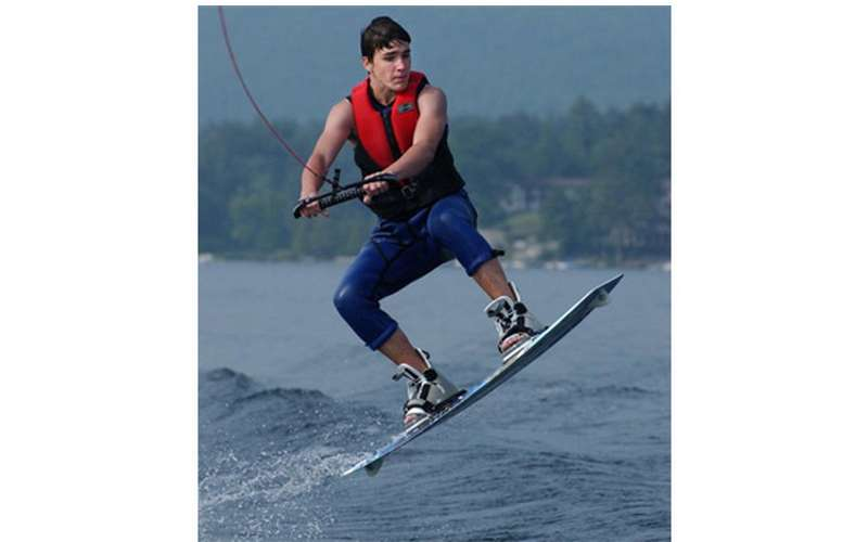 Young man jumping on a wakeboard