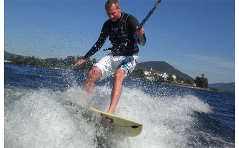 Man wake-surfing