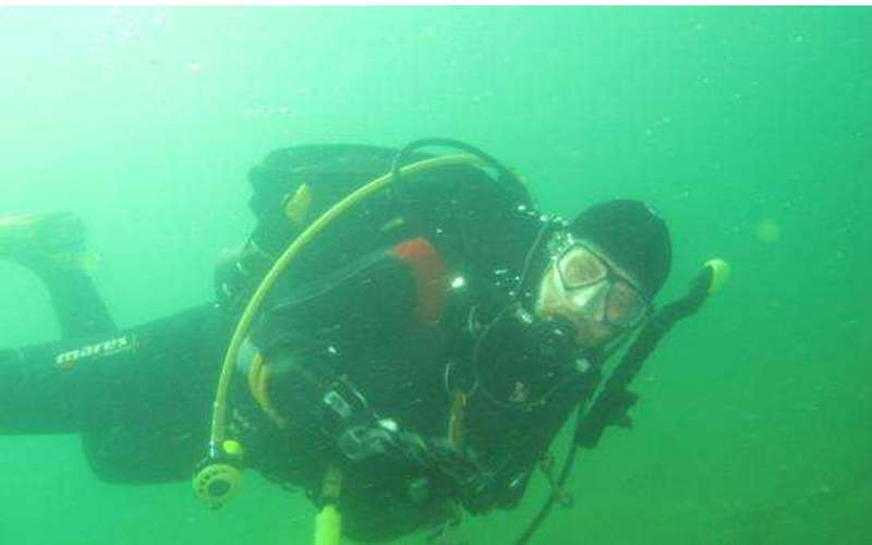 Underwater view of a scuba diver in Lake George