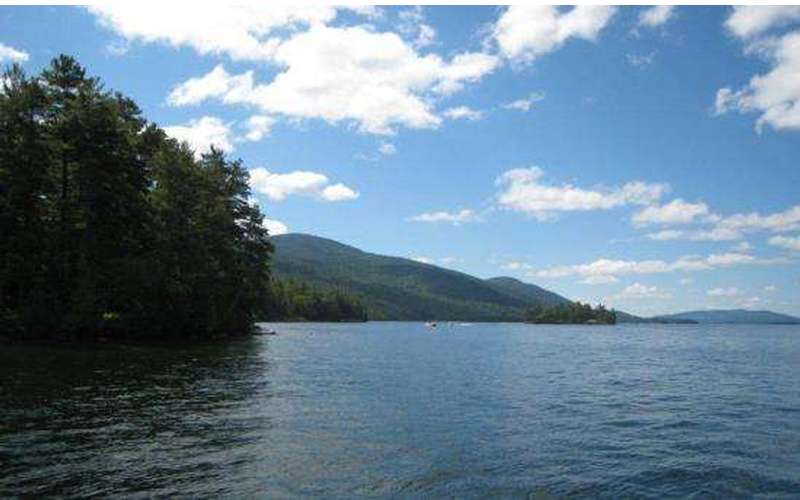 A view of islands in Lake George with surrounding mountains