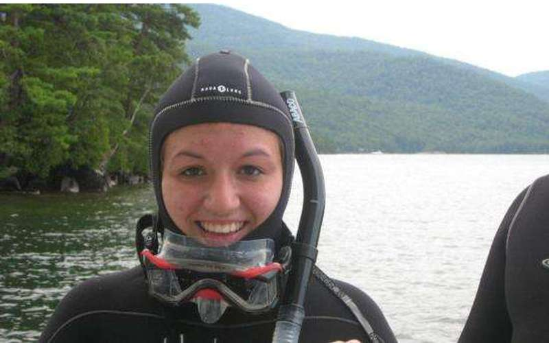 A girl smiling with a snorkeling mask on