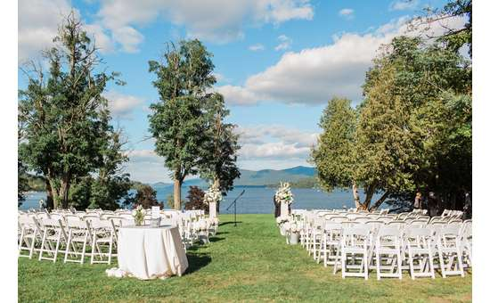 Empty chairs for wedding ceremony by Lake