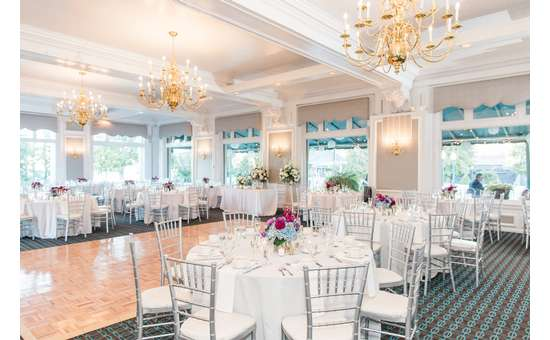 White lion wedding room filled with tables