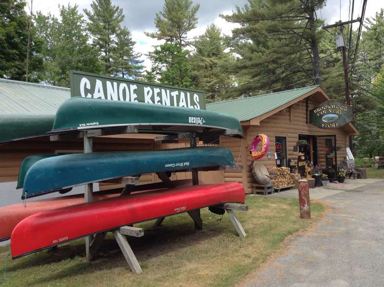 sign that says canoe rentals with canoes