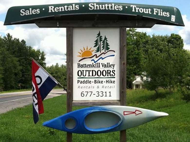battenkill valley outdoors sign with a kayak mounted to it