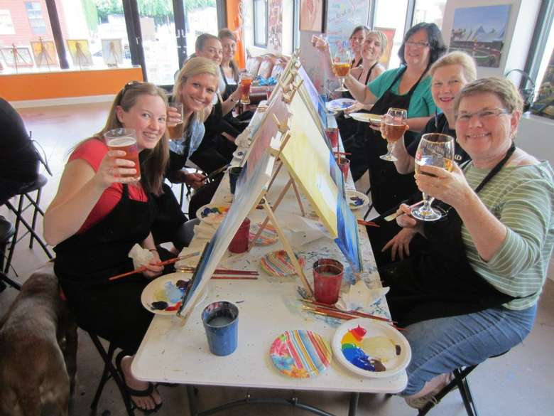 group of people painting during a paint and sip