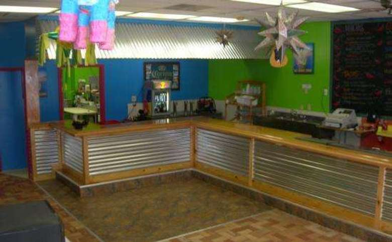 The colorful bright blue and green interior, with a long L-shaped counter