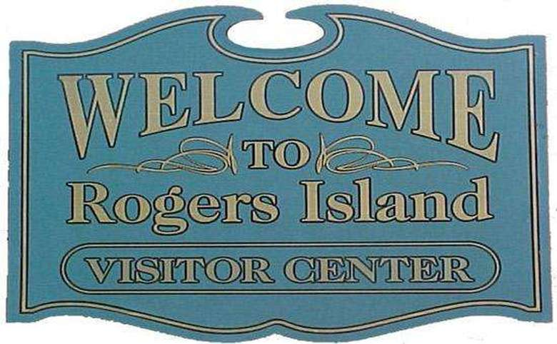 "A sign that says ""Welcome to Rogers Island Visitor Center"""