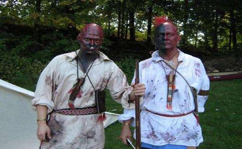 Two costumed reenactors dressed as Native Americans