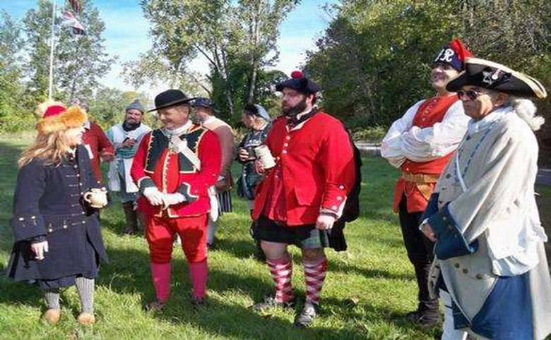 Costumed reenactors chatting with eachother